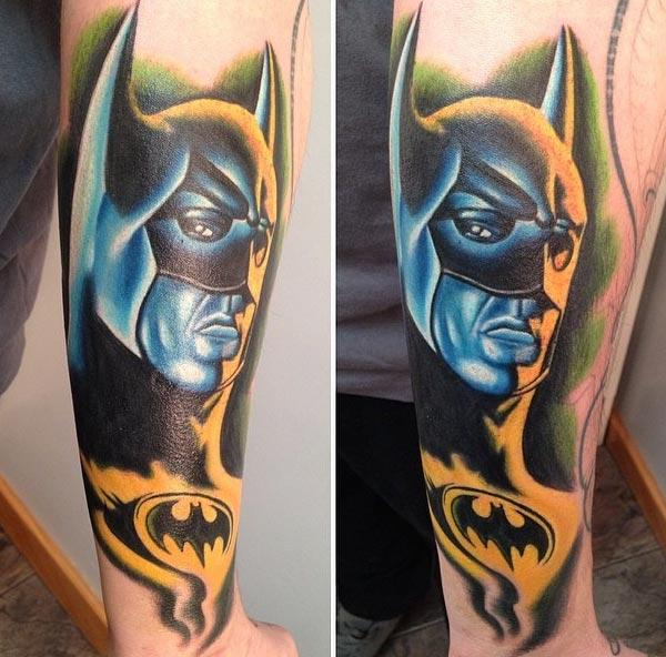 Batman tattoo on the front lower arm make a girl look exquisite