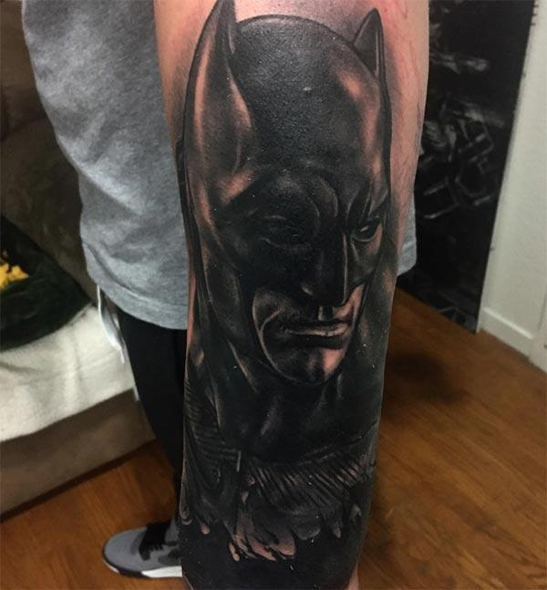 Batman tattoo on the lower side arm makes a man have a dapper look