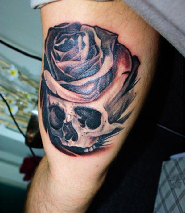 Bicep Tattoo for men with a flower ink design makes them look marvelous