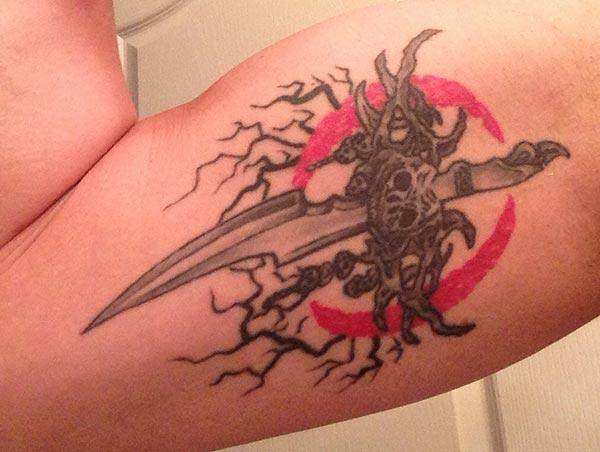 Bicep Tattoo for men with a sword design make them look foxy