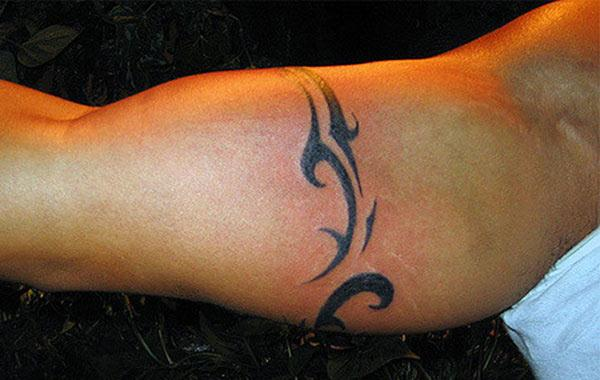 Bicep Tattoo for men with the black design makes them look attractive