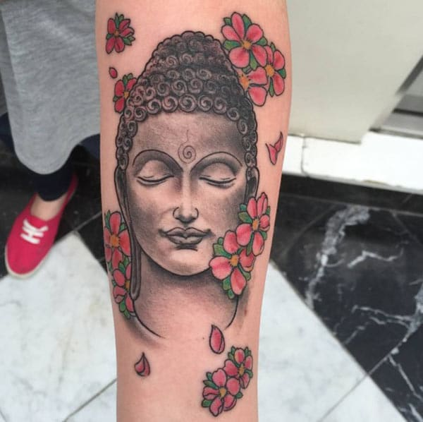 Buddha tattoo on the arm brings the astonishing look