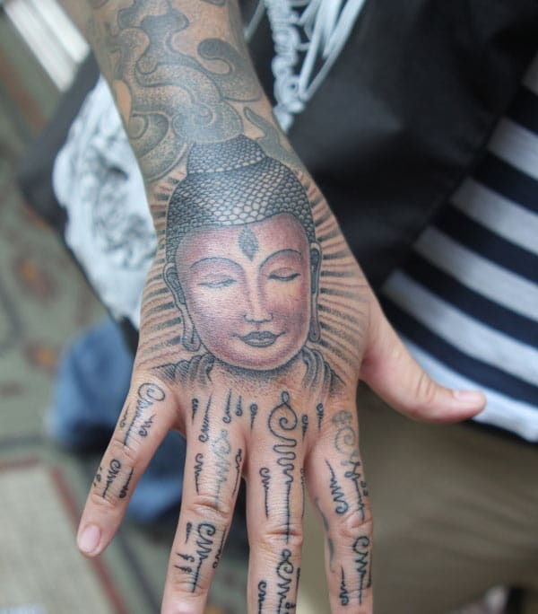 Buddha tattoo on the hand makes a man look stylish