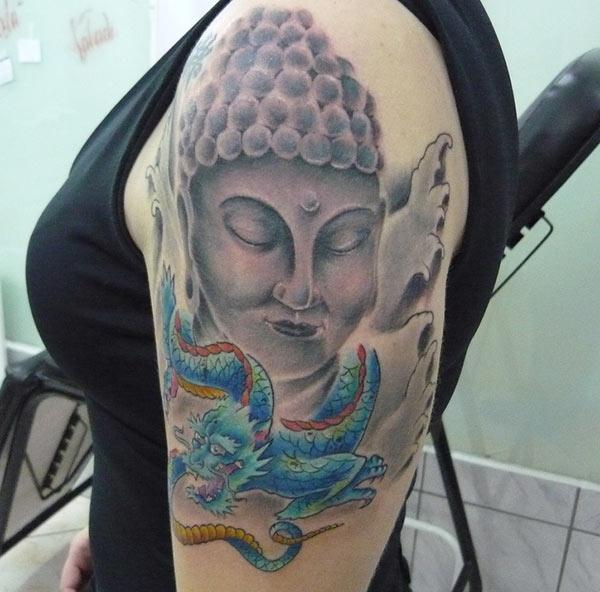 `Buddha tattoo on the shoulder makes a woman look captivating