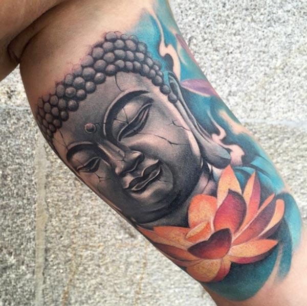 Buddha Tattoo for men with anorange design ink flower make them look attractive