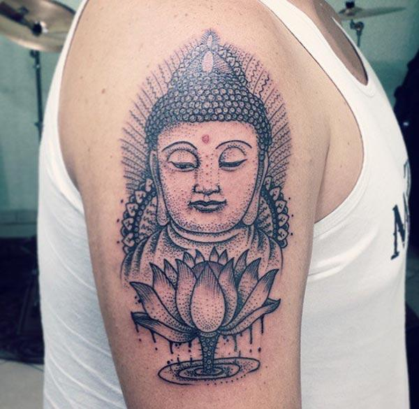 Buddha Tattoo on the shoulder brings the charming look