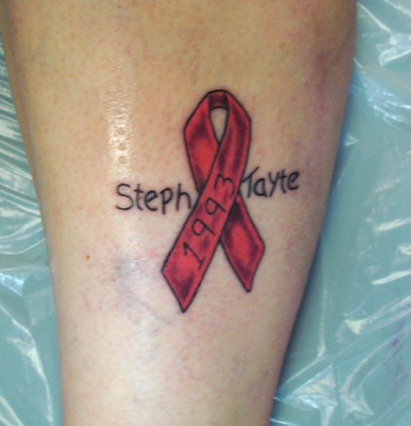 Cancer Ribbon tattoo on the foot brings the grievous look
