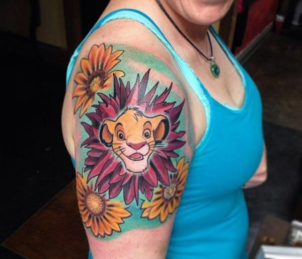 Disney Tattoo with orange and purple ink design makes a woman look attractive