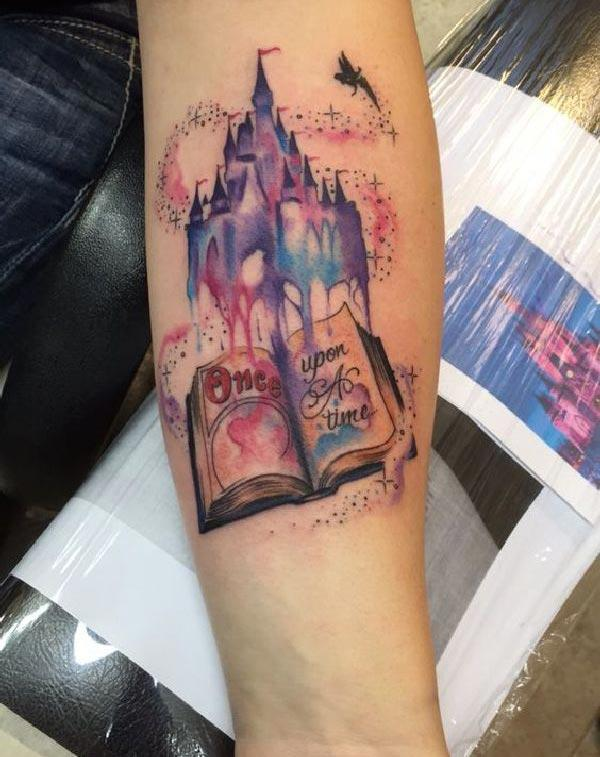 Disney Tattoo with a blue ink design on the lower arm shows their foxy look