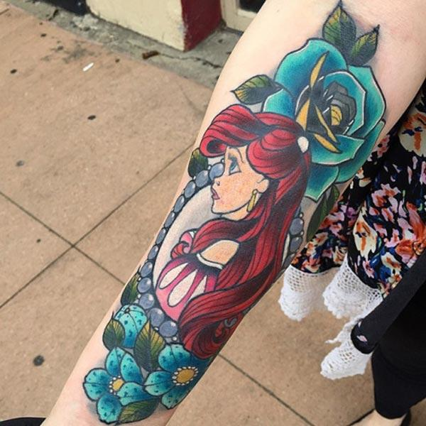 Disney Tattoo on the lower arm makes a lady look exquisite