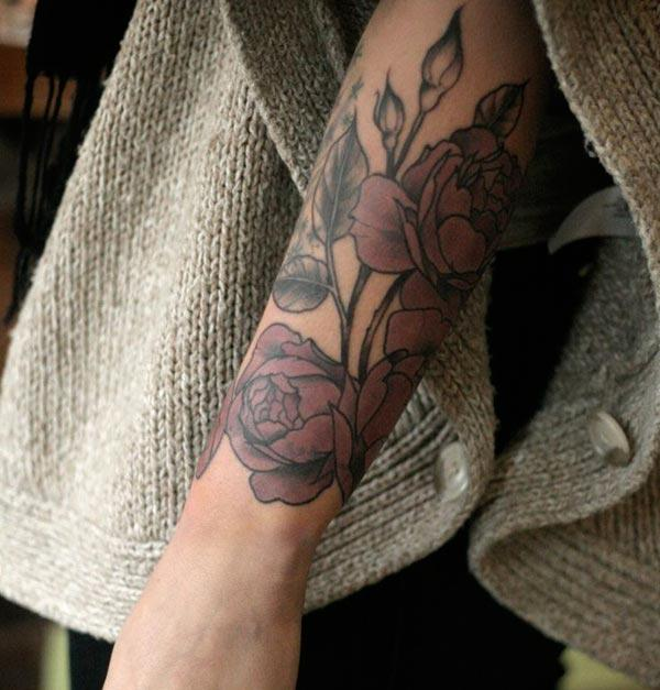 Forearm Tattoo with a flower design makes a man look elegant