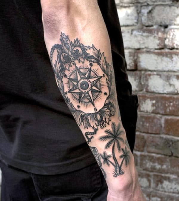 Forearm Tattoo with a black ink design decorations make a guy Attractive
