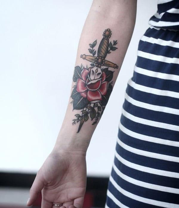 Forearm Tattoo with a sword and pink flower brings the enthralling look in them