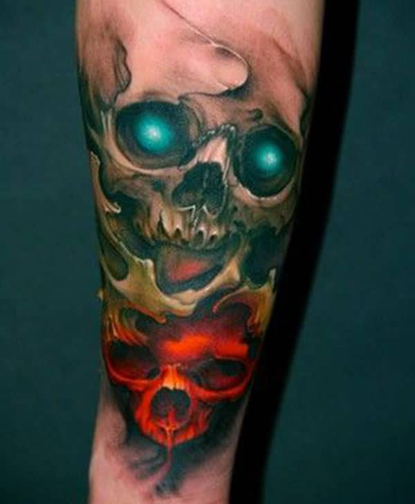 Forearm Tattoo with brown, blue and pink ink design make a man look Stunning