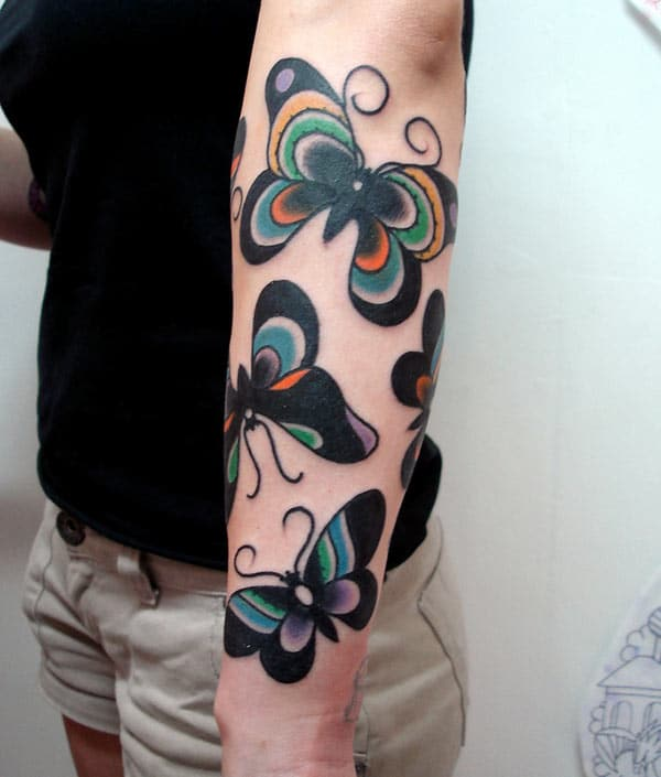 Forearm Tattoo with a black butterfly ink design make ladies have dazzling appearance