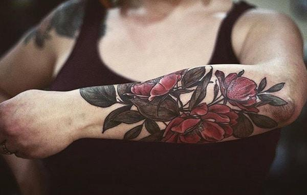 Girls go for a Forearm Tattoo with a pink ink flower design to bring their pretty look.