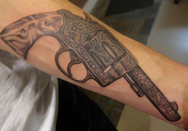 Gun Tattoo on the lower arm makes a man look cool