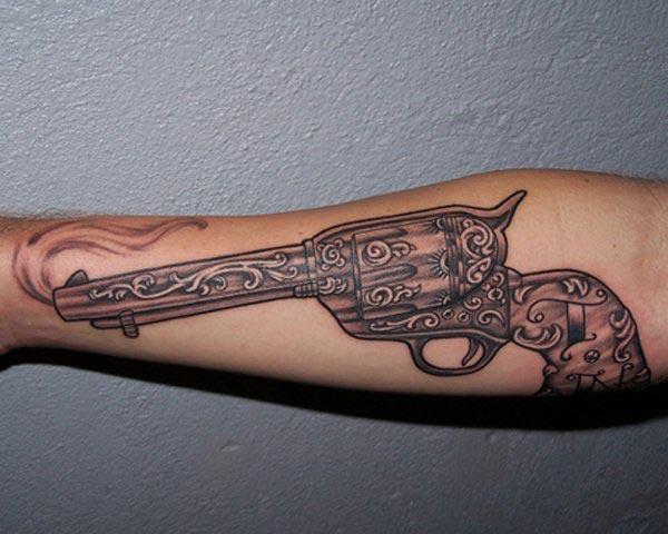 Gun Tattoo on the arm brings the astonishing look