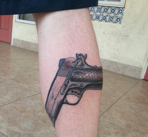 Gun Tattoo on the foot brings the stylish look