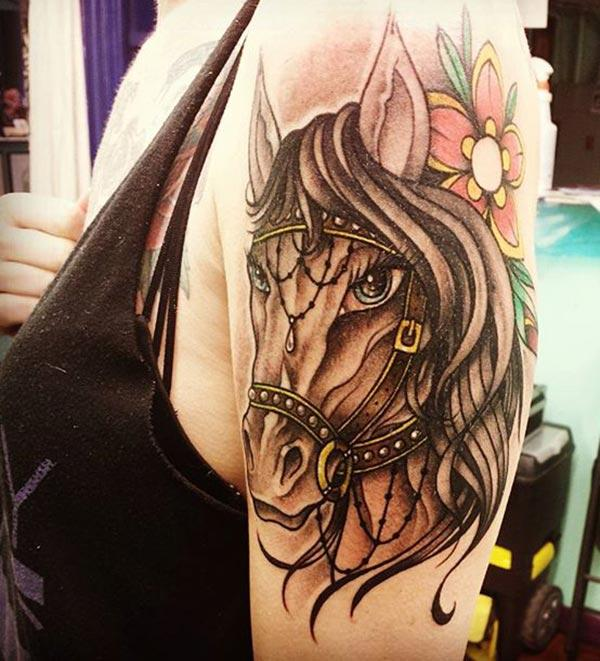 Horse tattoo on the upper arm makes a girl look so cute