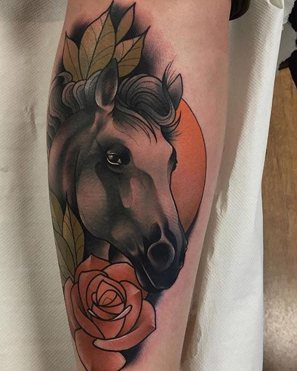 Horse tattoo on the shoulder with a black ink design make a man look foxy
