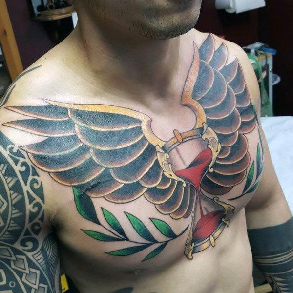 Hourglass tattoo on the upper chest makes a man look elegant