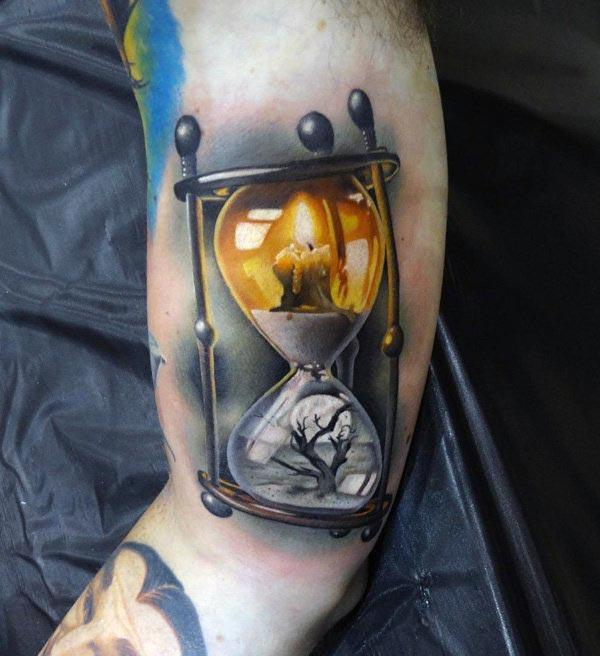 Hourglass tattoo with dark and yellow ink design makes a man look cute