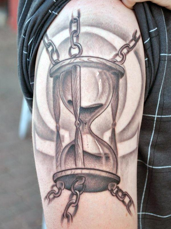 Hourglass tattoo on the right upper arm, make men look more attractive