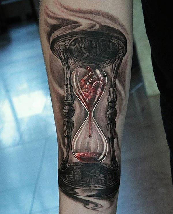 Hourglass tattoo on the lower arm makes a man look captivating