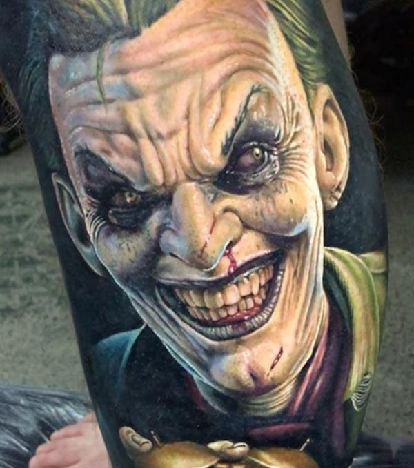Joker Tattoo on the foot brings the majestic gaze