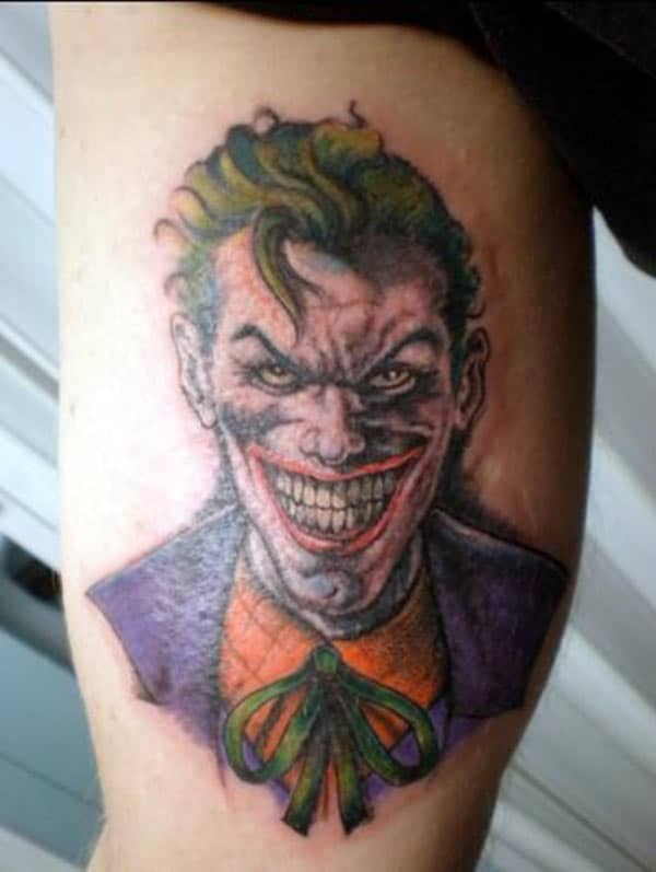 Joker Tattoo for men with purple ink design makes a man look classy