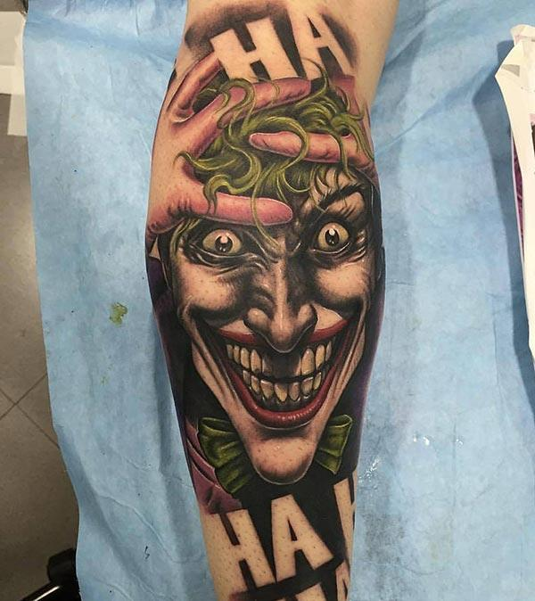 Joker Tattoo with a brown ink design on the lower arm shows their foxy look