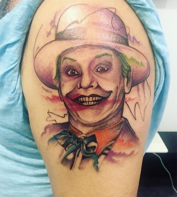 Joker Tattoo on the upper arm, make men look more attractive