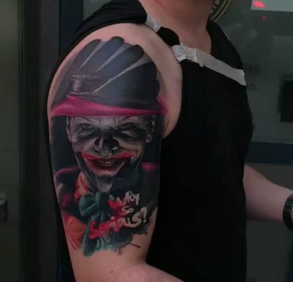 Joker Tattoo on the upper arm makes a man look cool