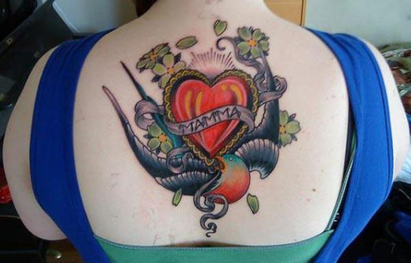 Mom tattoo on the back with a pink love, ink design brings the captivating look