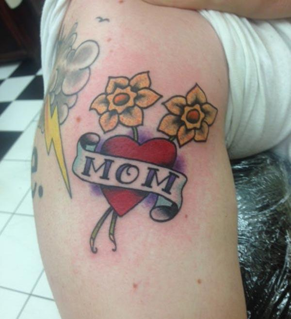 Mom Tattoo for men with a pink love and flower design make them look attractive