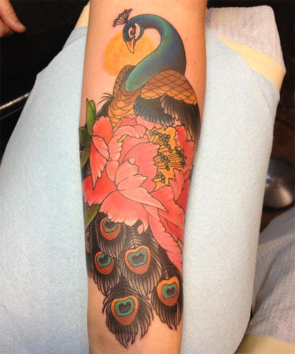 Peacock Tattoo on the lower arm brings the astonishing look
