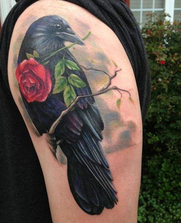 Raven tattoo with a pink flower ink design makes a man look cute