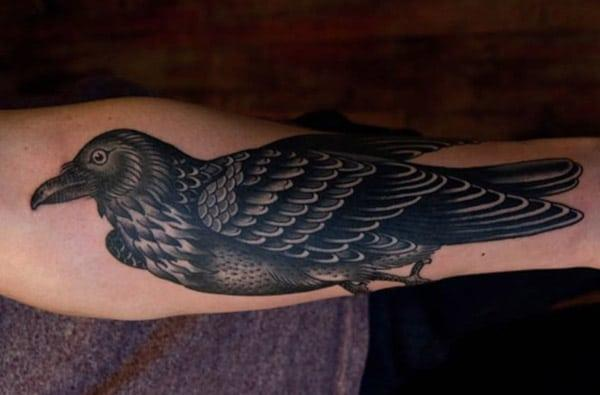 Raven tattoo on the lower front arm make beings the foxy look