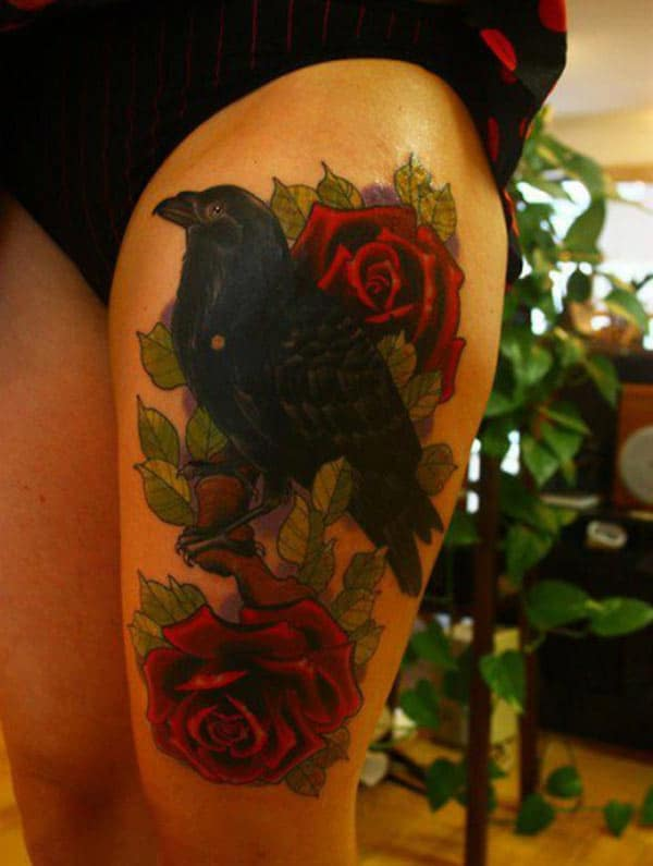 Raven tattoo on the side thigh gives the girls an attractive look