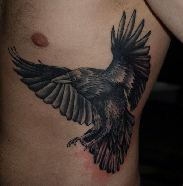 Raven tattoo below the armpits make a man look cool
