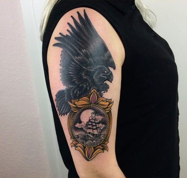 Raven tattoo for the shoulder gives the captive look in girls