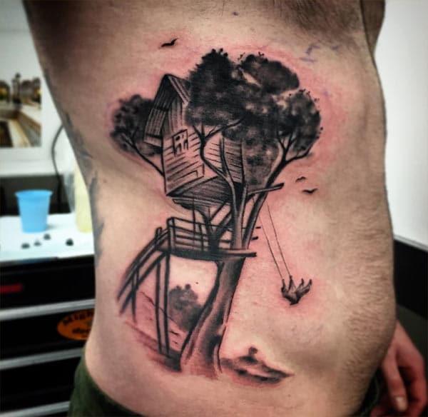 I-tattoo yangaphandle yabesilisa abanesakhiwo sendlu yenza kubonakale kumangalisa