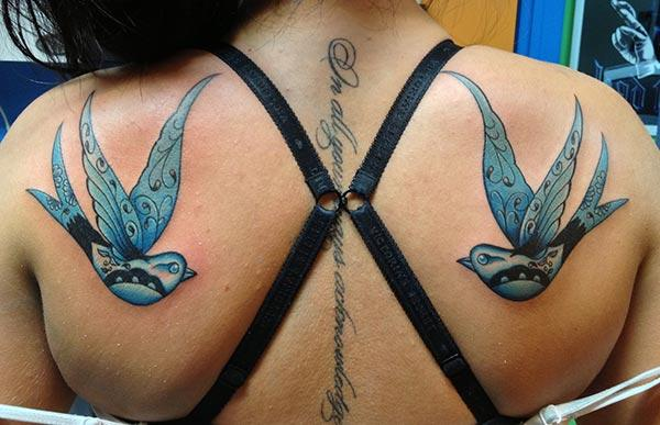 Sparrow tattoo on the back make a girl attractive and elegant