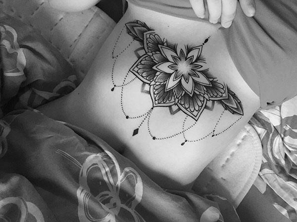 Sternum tattoo for Women with a flower design makes them look captivating