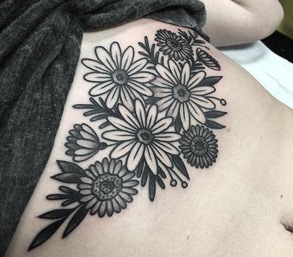 Sternum tattoo for Women with a flower design bring their charming look