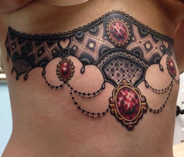 Sternum tattoo for Women with brown ink design make them look classy