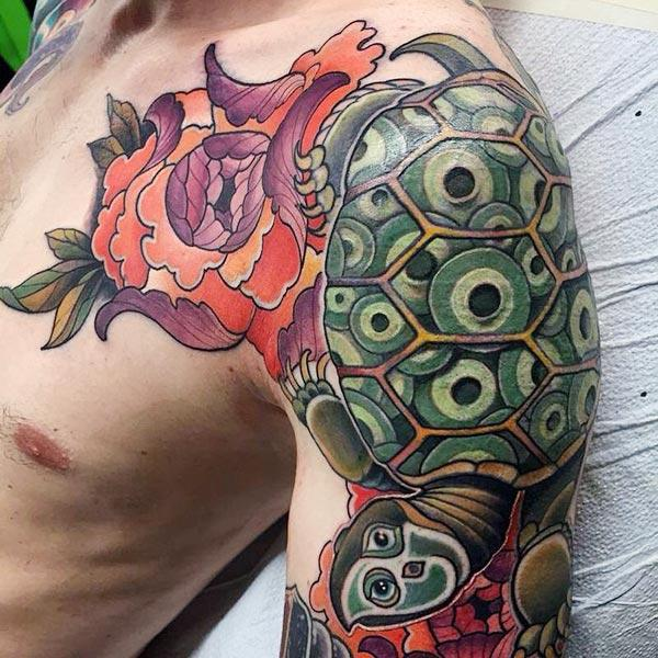 Turtle tattoo on the left upper arm make a man look elegant