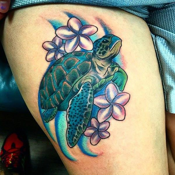 Turtle tattoo for the thigh brings their feminist look.