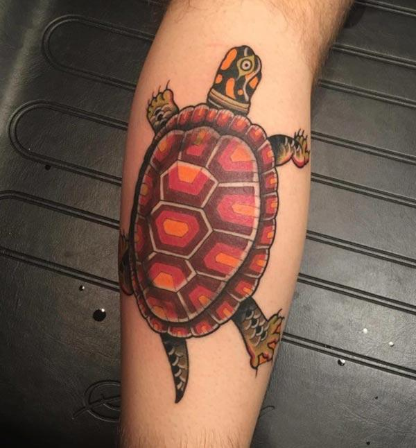 Turtle tattoo on the right arm make a man look cool